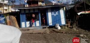 Simbol-israil-di-dinding-rumah-warga-Tolikara-Papua.