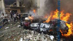 Lebanese firefighters extinguish burning cars at the scene of an explosion in the mostly Christian neighborhood of Achrafiyeh, Beirut, Lebanon, Friday Oct. 19, 2012. Lebanon's state-run news agency says a massive blast in east Beirut was caused by a car bomb and that there are casualties. An Associated Press reporter at the scene saw bloodied people being helped into ambulances and heavy damage to what appeared to be residential buildings. (AP Photo/Hussein Malla)