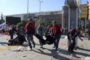 "ATTENTION EDITORS - VISUAL COVERAGE OF SCENES OF INJURY OR DEATH People carry an injured man after an explosion during a peace march in Ankara, Turkey, October 10, 2015. At least one explosion shook a road junction in the centre of the Turkish capital Ankara on Saturday, causing many casualties including fatalities, local media said. The state-run Anadolu Agency said there were reports that the blast was caused by a suicide bomber, but the source of those reports was unclear. The blast occurred ahead of a planned ""peace"" march to protest against the conflict between the state and Kurdish militants in southeast Turkey. Earlier media reports had said there were two explosions. REUTERS/Tumay Berkin"